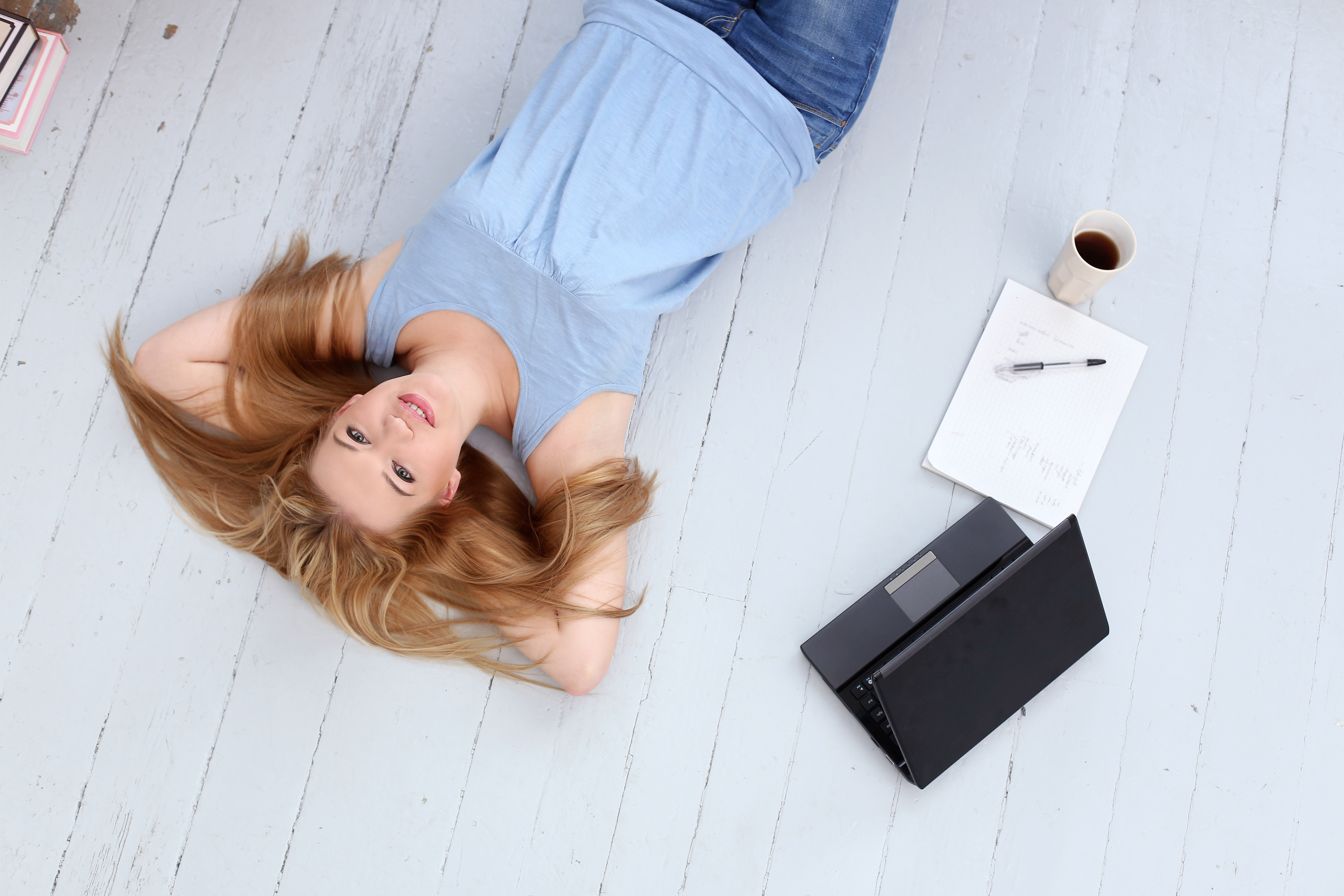 Woman on floor with laptop