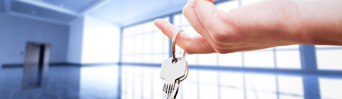 Short banner womans hand holding the keys to an apartment pwn6txe