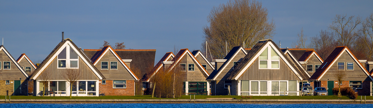 Short banner panorama of holiday resort houses